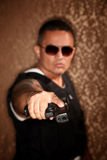 Hispanic Cop Pointing Gun Royalty Free Stock Image