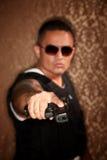 Hispanic Cop Pointing Gun Royalty Free Stock Image