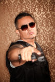 Hispanic Cop Pointing Gun Stock Photos
