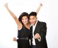 Hispanic couple arms up Royalty Free Stock Photography