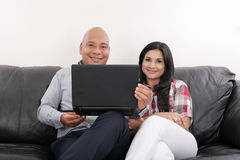 Hispanic Couple on Black Couch Royalty Free Stock Image