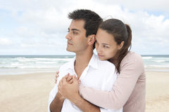 Hispanic couple bonding on beach Stock Photography