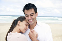 Hispanic couple bonding on beach Royalty Free Stock Photo