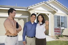 Hispanic Couple Buying House Stock Image