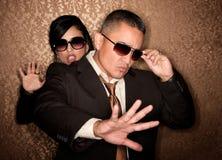Hispanic couple caught in photographer flash Stock Photos