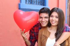 Hispanic couple celebrating Saint Valentines day.  stock images