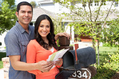 Hispanic Couple Checking Mailbox Royalty Free Stock Images