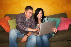 Hispanic Couple with Computer Stock Photos
