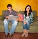 Hispanic Couple with Computer Stock Image