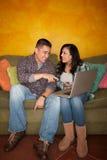 Hispanic Couple with Computer Stock Photo