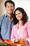Hispanic couple cooking royalty free stock image