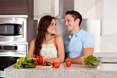 Hispanic couple cooking dinner Royalty Free Stock Photo