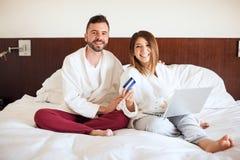 Hispanic couple doing some online shopping Stock Photography
