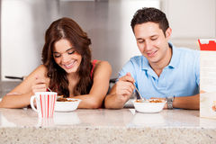 Hispanic couple eating breakfast Stock Images