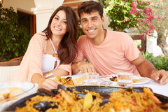 Hispanic Couple Enjoying Outdoor Meal At Home Together Stock Photography