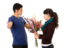 Hispanic couple facing each other and woman Stock Photo