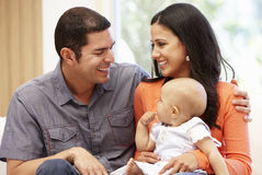 Hispanic couple at home with baby Royalty Free Stock Photography