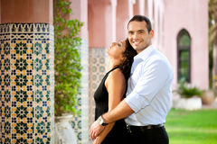 Hispanic couple hugging outdoors Royalty Free Stock Images