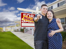 Hispanic Couple with Keys In Front of Home and Sign Stock Photography