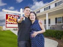Hispanic Couple with Keys In Front of Home and Sign Royalty Free Stock Photography