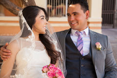 Hispanic couple in love. Young Hispanic couple looking at each other and smiling on their wedding day Royalty Free Stock Image