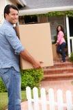 Hispanic couple moving into new house. Smiling at camera stock image
