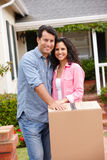 Hispanic couple moving into new house. Smiling at camera royalty free stock images