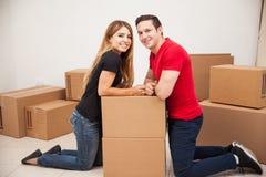 Hispanic couple moving in Stock Image
