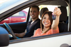 Hispanic couple with a new car Royalty Free Stock Photography