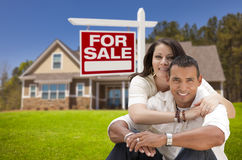 Hispanic Couple, New Home and For Sale Real Estate Sign Stock Image