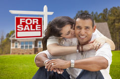 Hispanic Couple, New Home and For Sale Real Estate Sign Royalty Free Stock Image