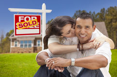 Hispanic Couple, New Home and Sold Real Estate Sign Stock Photos