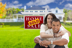 Hispanic Couple, New Home and Sold Real Estate Sign Royalty Free Stock Photo