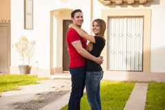 Hispanic couple with a new house Royalty Free Stock Photography