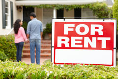 Hispanic couple outside home for rent Stock Photography