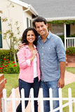 Hispanic couple outside new home. Smiling hispanic couple outside new home Royalty Free Stock Images