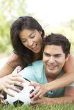 Hispanic Couple In Park With Soccer Ball Royalty Free Stock Photos