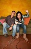 Hispanic Couple Playing Video game Stock Photos