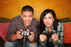Hispanic Couple Playing Video game Stock Images