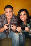 Hispanic Couple Playing Video game Royalty Free Stock Image