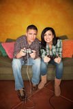 Hispanic Couple Playing Video Game Royalty Free Stock Photo