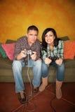 Hispanic Couple Playing Video Game Royalty Free Stock Photo