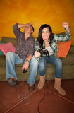 Hispanic Couple Playing Video Game Royalty Free Stock Image