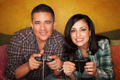 Hispanic Couple Playing Video game Stock Photography