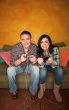 Hispanic Couple Playing Video game Stock Photo