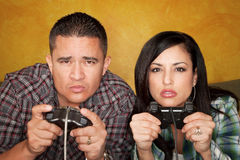 Hispanic Couple Playing Video game Stock Photos
