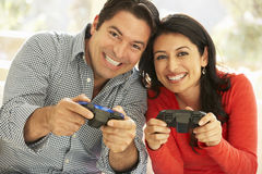 Hispanic Couple Playing Video Game At Home Royalty Free Stock Image