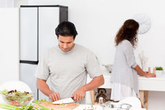 Hispanic couple preparing a salad together Royalty Free Stock Image