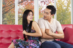 Hispanic couple quarreling on sofa Royalty Free Stock Photography