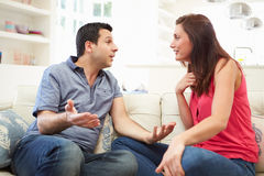 Hispanic Couple Sitting On Sofa Arguing Royalty Free Stock Images